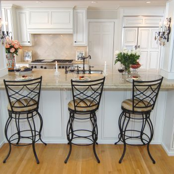 kitchen cabinets in antique white with light glaze