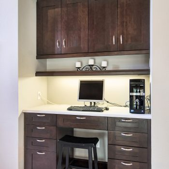 kitchen cabinets used as a desk