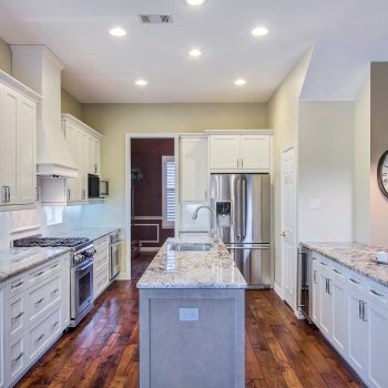 white cabinets with light gray island