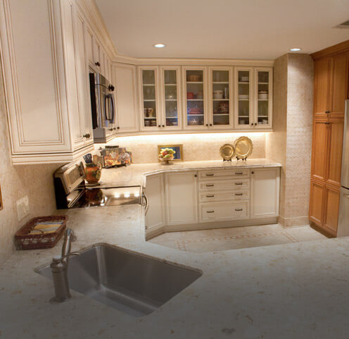 Antique white cabinets with brown glaze on a pillow door style