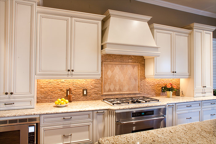 traditional white kitchen cabinets with dark islands